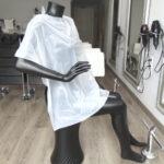 capa de tinte desechable de peluquería blanca