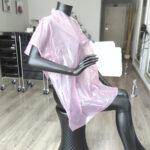 capa de tinte desechable de peluquería rosa