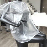 capa de tinte desechable de peluquería transparente